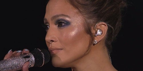 The only thing as shiny as J. Lo's mic is her awesome glitter make-up!