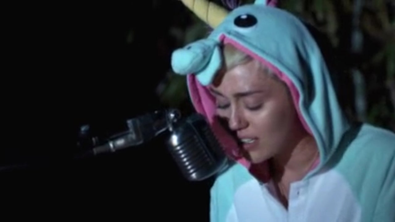 a devastated miley cyrus cries while singing a song she wrote