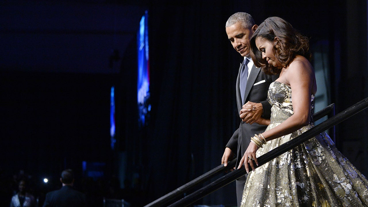 First Lady Michelle Obama Stuns in Gold at Congressional Black Caucus Awards   Entertainment Tonight