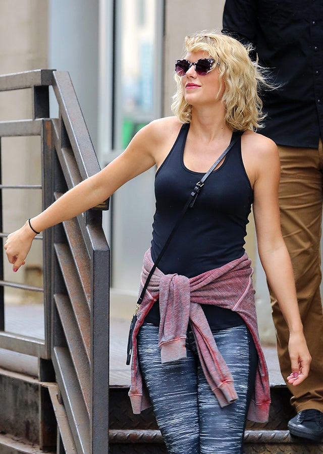 taylor swift steps out with a coy smile in first sighting