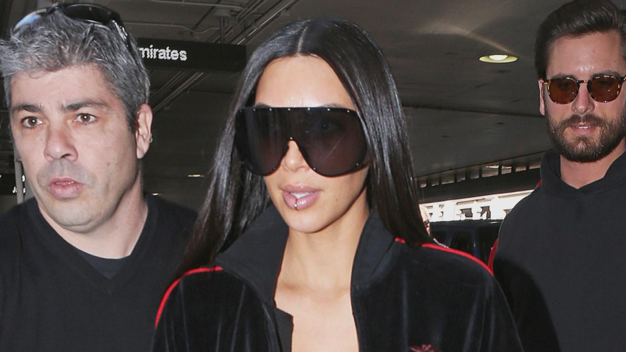 Kim Kardashian Rocks Lip Ring and Simple Wedding Band to Dubai in