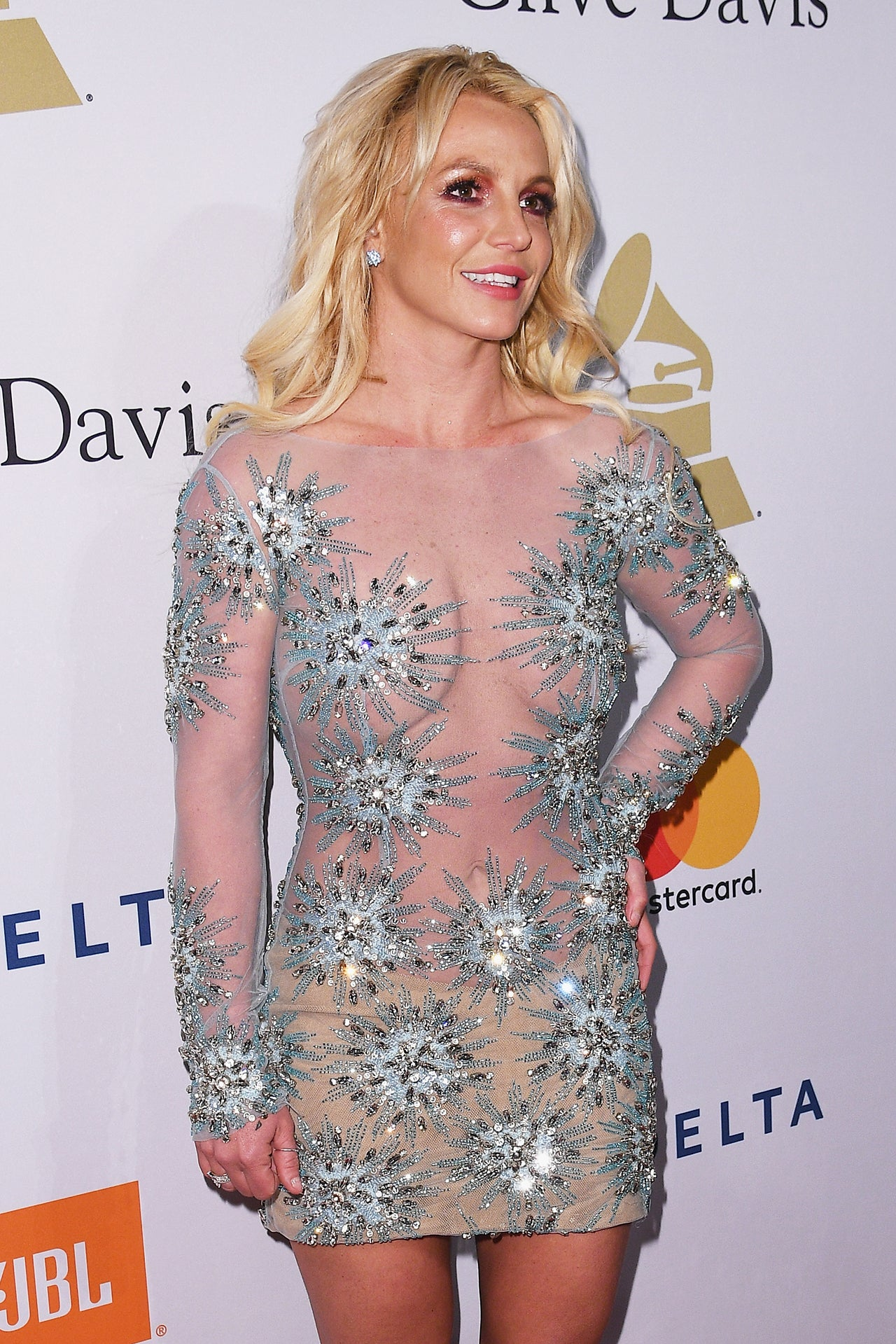 Britney Spears Dazzles in a Sheer Dress at the Clive Davis Pre ...