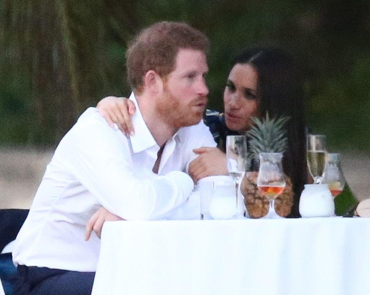 prince harry and meghan markle adorable pda at