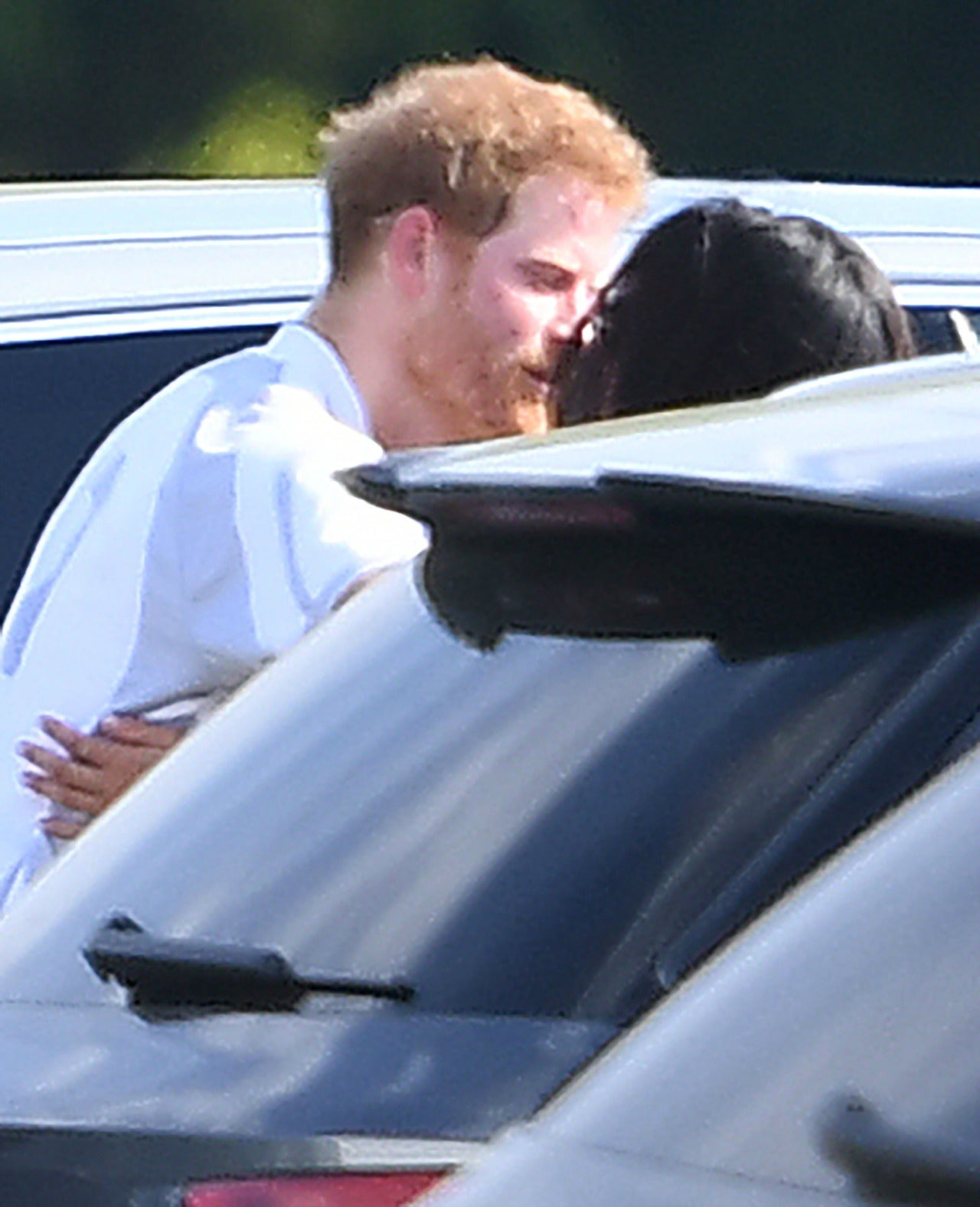 Prince Harry And Meghan Markle Adorably Kiss, Embrace