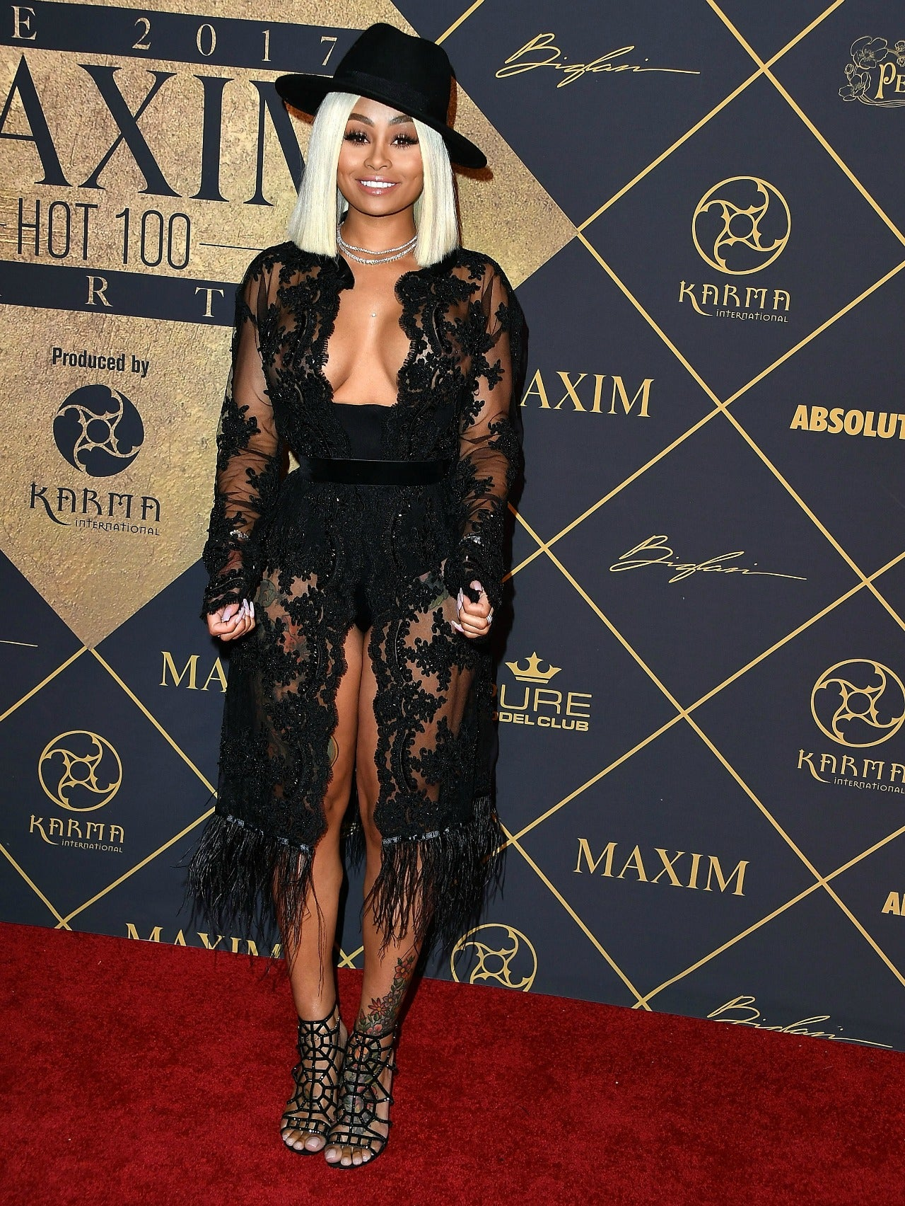 Blac Chyna All Smiles In Cleavage Baring Dress Following