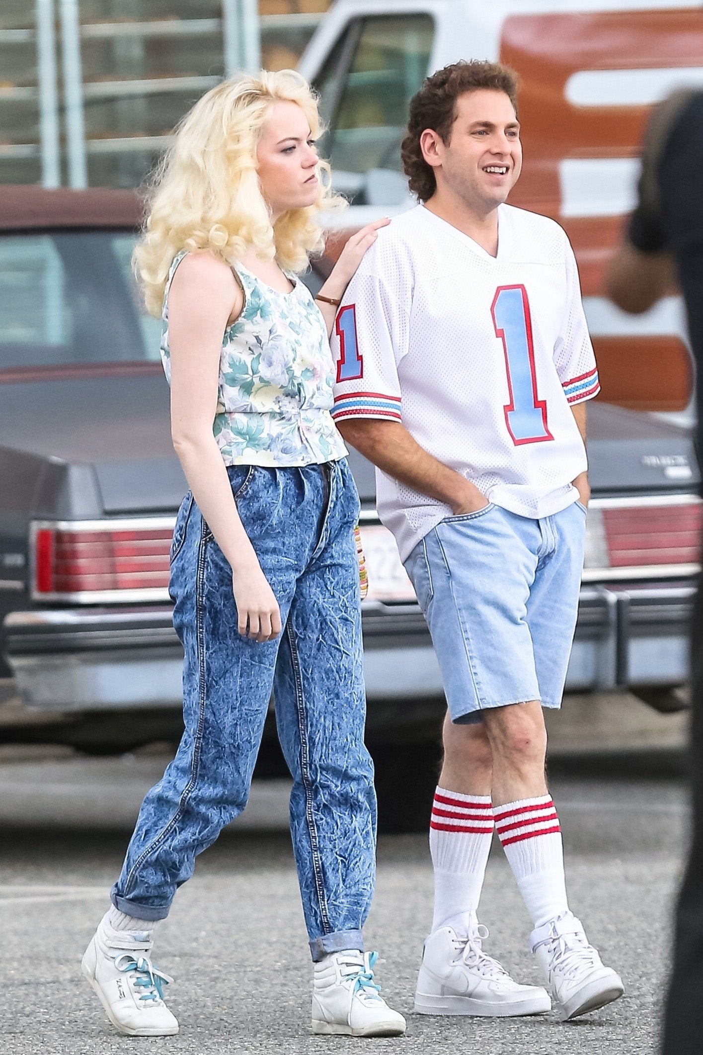 Actors Emma Stone and Jonah Hill take it back to the 80's while filming their upcoming Netflix series 'Maniac' in New York City. A slimmed down Jonah was sporting a sweet mullet on set.
