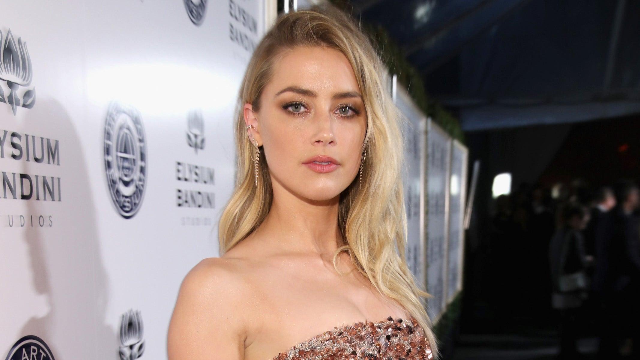Amber Heard Topless amber heard goes topless in bikini bottoms on beautiful bali