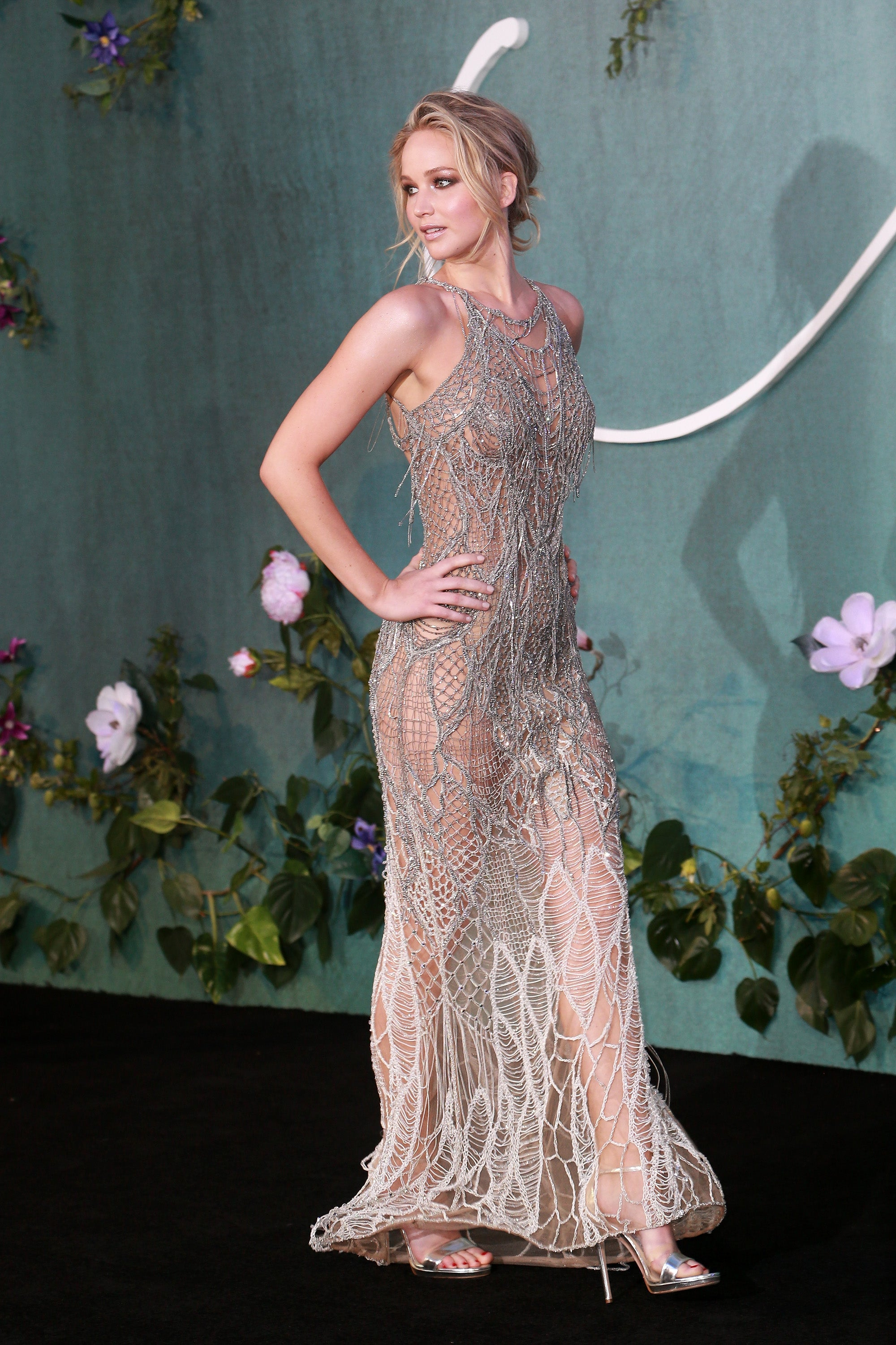 Jennifer Lawrence Turns Heads In Sheer Silver Gown At