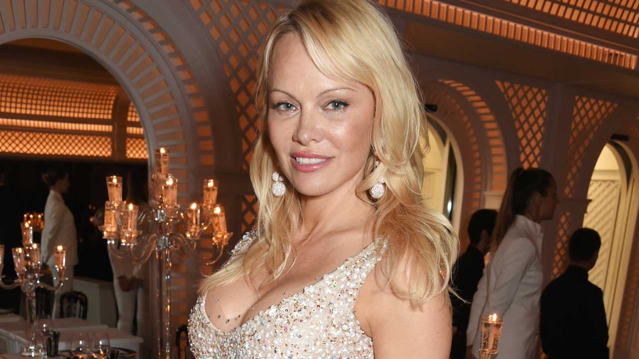 Pamela Anderson Still Wears Her Iconic 'Baywatch' Swimsuit to Surprise Her Love Interests