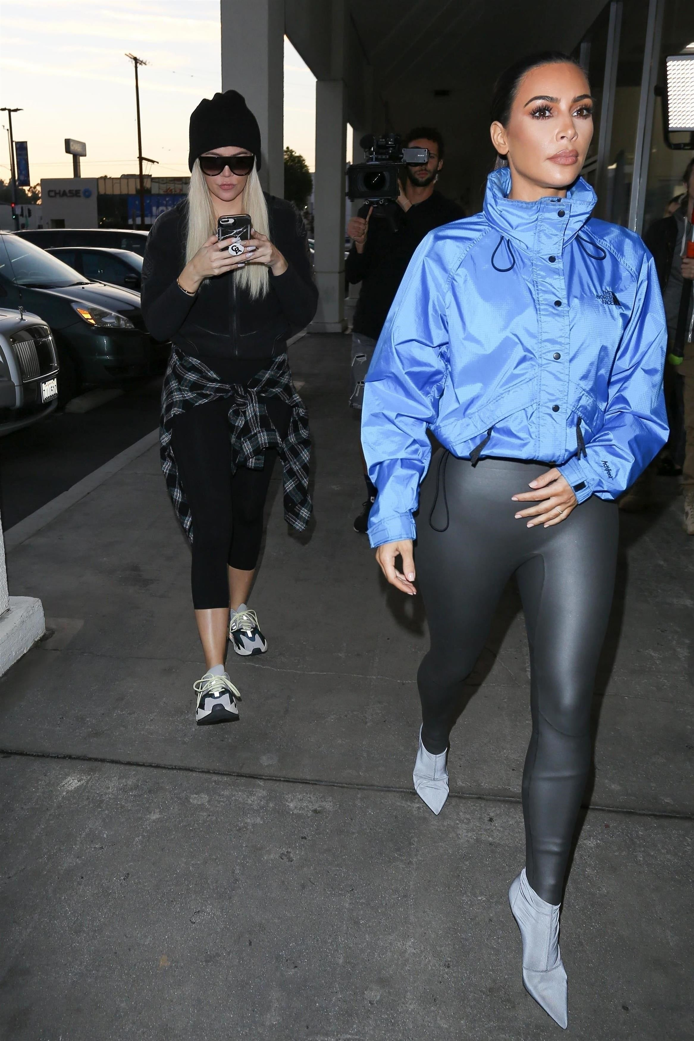e3f20f3592113 Kim Kardashian Looks Incredible in Skin-Tight Rubber Leggings With Sister  Khloe