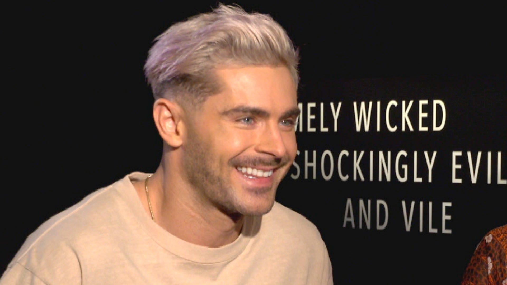 Zac Efron Explains His Platinum Blonde Hair and Not,Quite Brad Pitt Abs  (Exclusive)