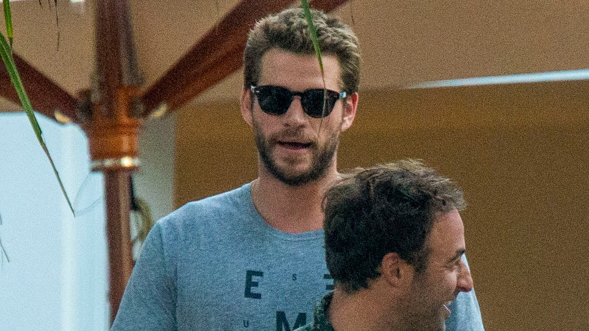 Liam Hemsworth Heads to a Bar With Friends Amid Miley Cyrus' Continued Outings With Kaitlynn Carter