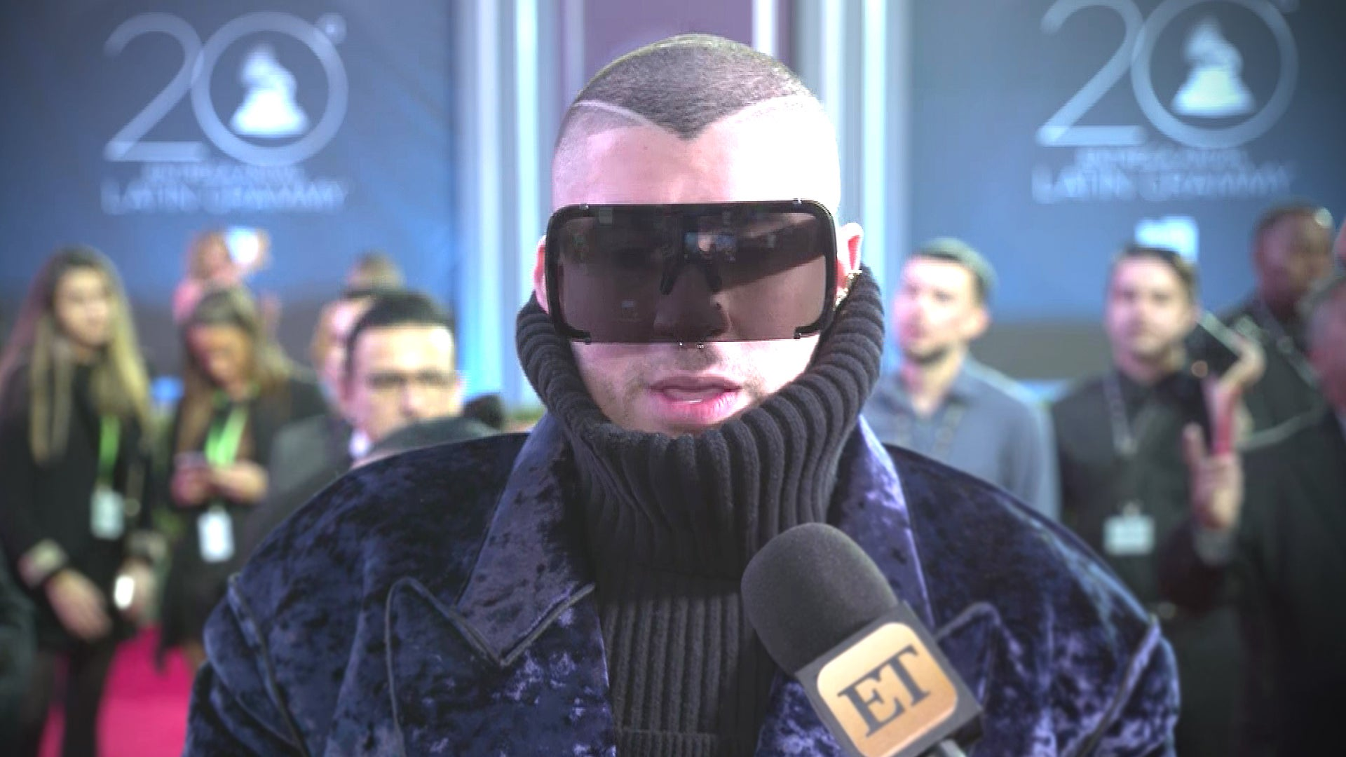 bad bunny honored to represent reggaeton at latin grammy awards exclusive entertainment tonight bad bunny adorably reacts to becky g saying he s going to change the world exclusive