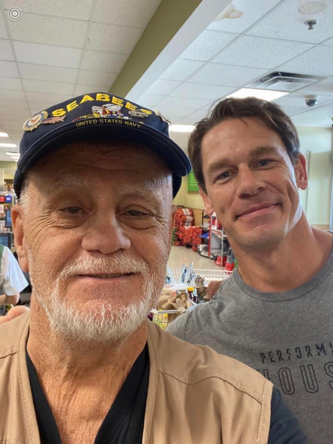 John Cena at grocery store with a vet, whose bill he paid.