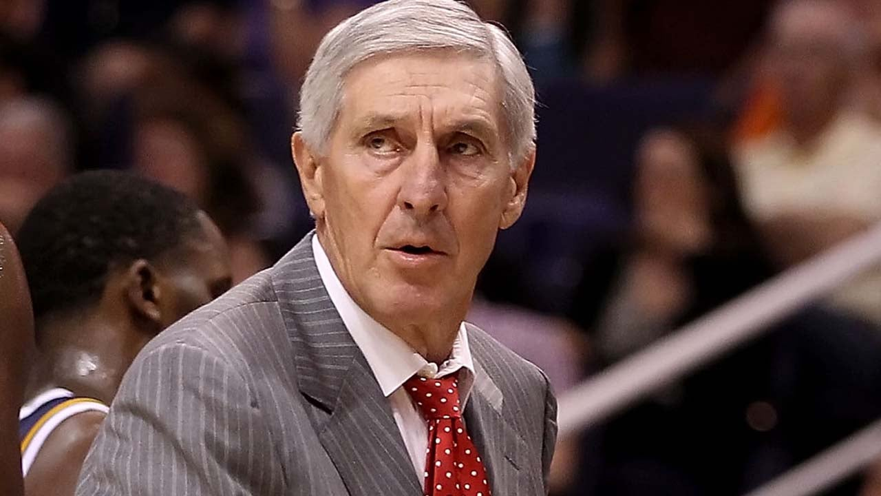 Head coach Jerry Sloan of the Utah Jazz talks with his team during the preseason NBA game against the Phoenix Suns at US Airways Center on October 12, 2010 in Phoenix, Arizona.
