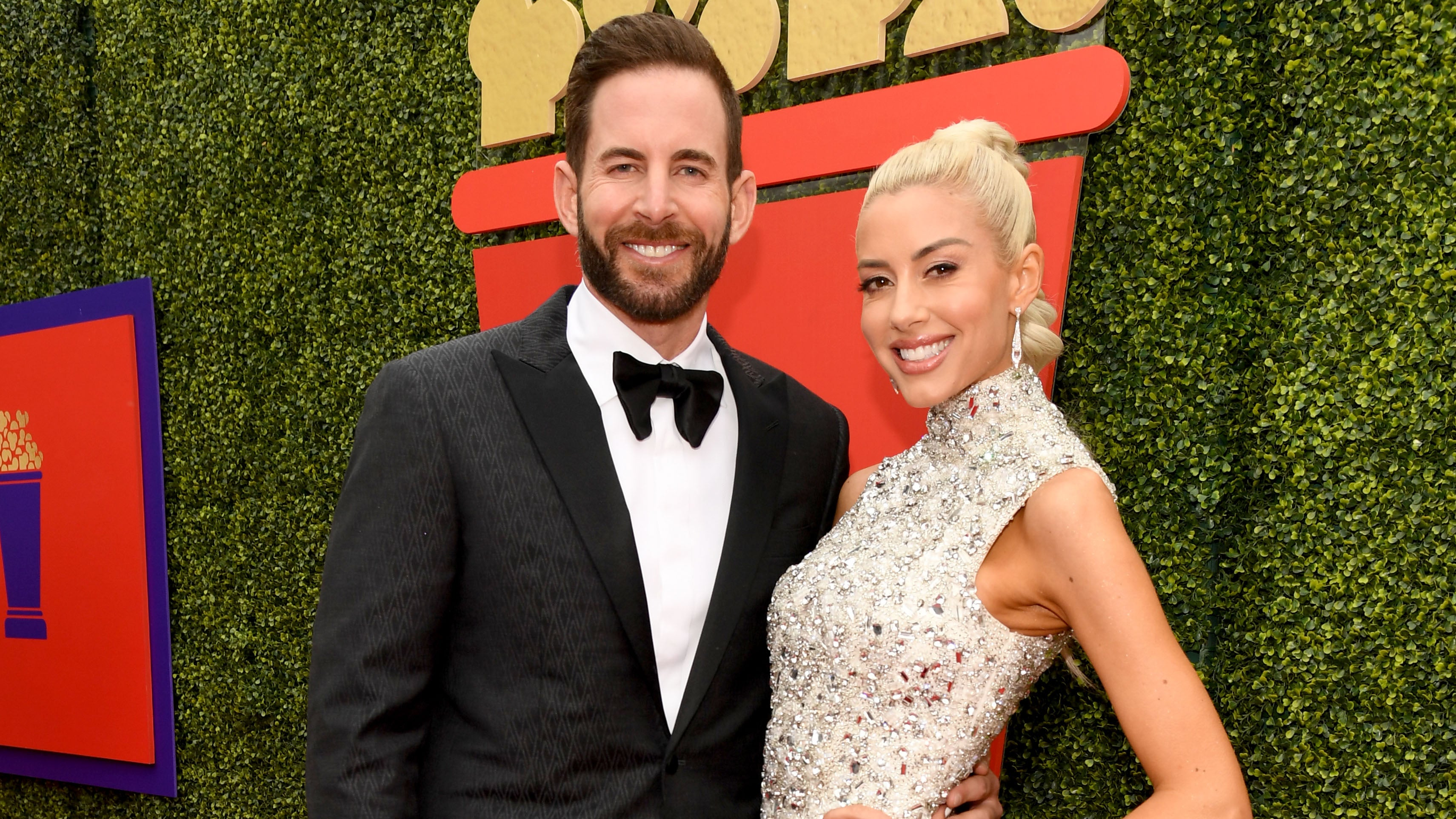 Tarek El Moussa and Heather Rae Young attend the 2021 MTV Movie & TV Awards: UNSCRIPTED in Los Angeles.