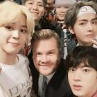 BTS poses with James Corden backstage at 'The Late Late Show'