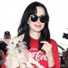 Krysten Ritter holds dog at LAX