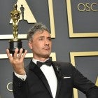 "taika Waititi, winner of the Adapted Screenplay award for ""Jojo Rabbit,"" poses in the press room during the 92nd Annual Academy Awards"