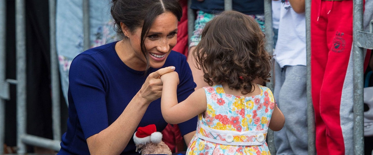 Meghan Markle with young girl in New Zealand