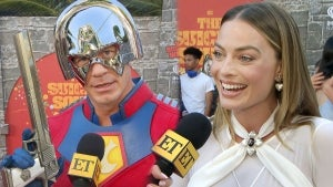 Margot Robbie Reacts to John Cena Dressing Up as Peacemaker for 'Suicide Squad' Premiere (Exclusive)