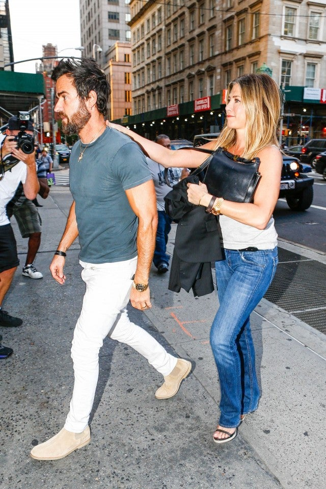 Jennifer Aniston Leans On Justin Theroux For Support