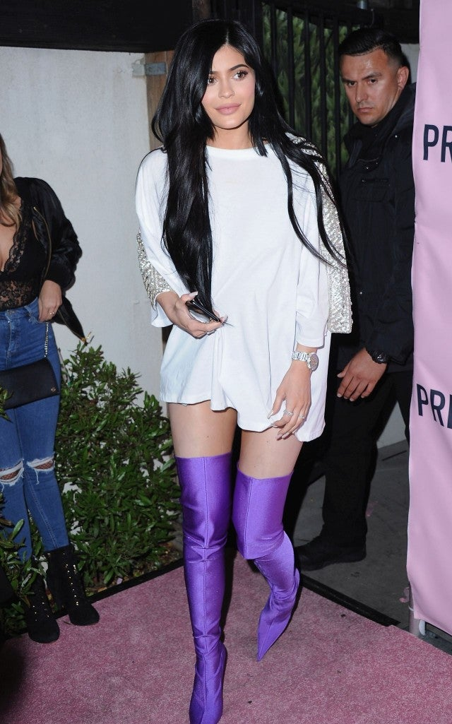 5332c87fffad7 Kylie Jenner Rocks Purple Thigh-High Boots With Oversized White T ...