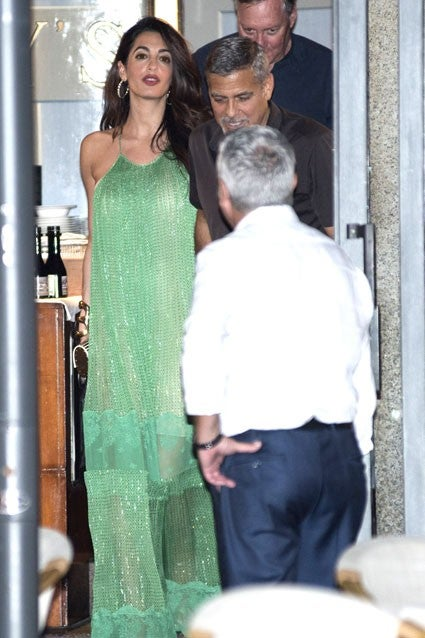 George and Amal spotted at Harry's Bar in Lake Como on Aug. 20, 2017.
