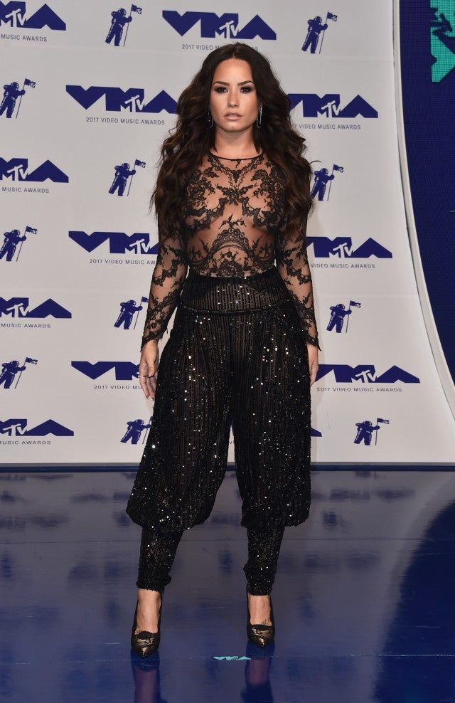 demi lovato turns heads in a sexy sheer lace number at