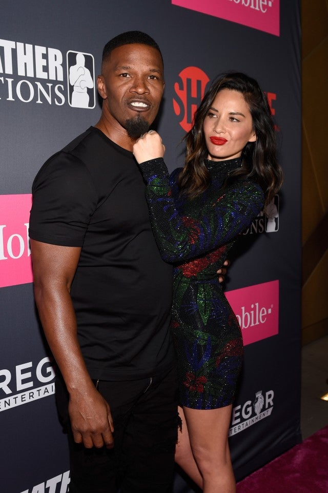 Jamie Foxx and Olivia Munn pose together at the Mayweather vs. McGregor fight