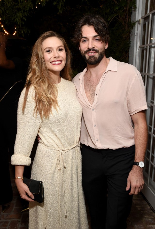 Elizabeth Olsen (L) and Robbie Arnett attend the 2017 Gersh Emmy Party presented by Tequila Don Julio 1942 on September 15, 2017 in Los Angeles, California.