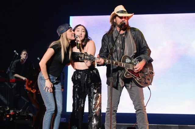 Miley Cyrus, Noah Cyrus, and Billy Ray Cyrus perform together