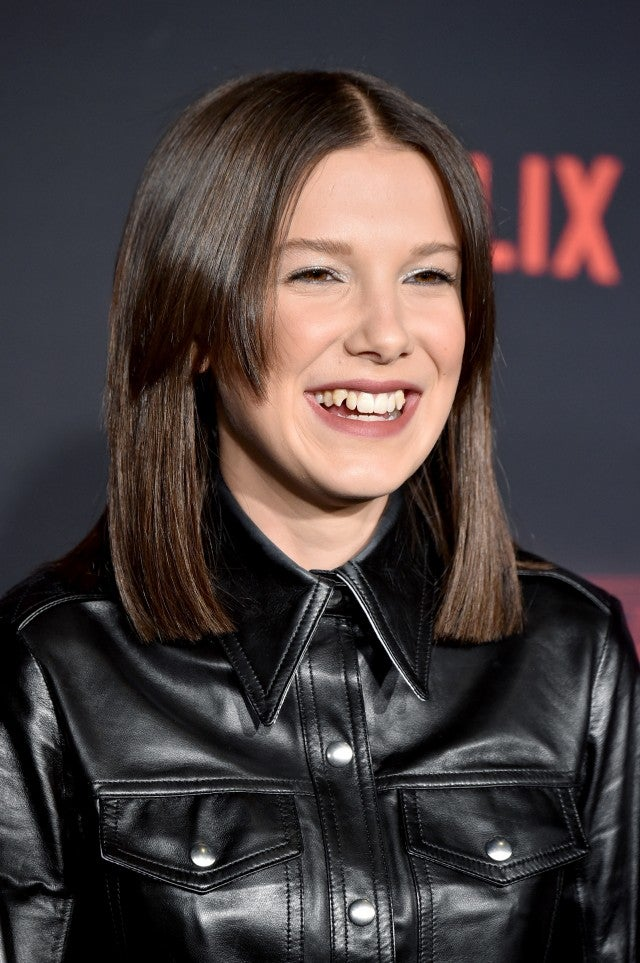 Millie Bobby Brown Debuts New Long Brown Do Laughs At