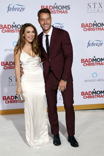 Justin Hartley and wife at A Bad Moms Christmas premiere