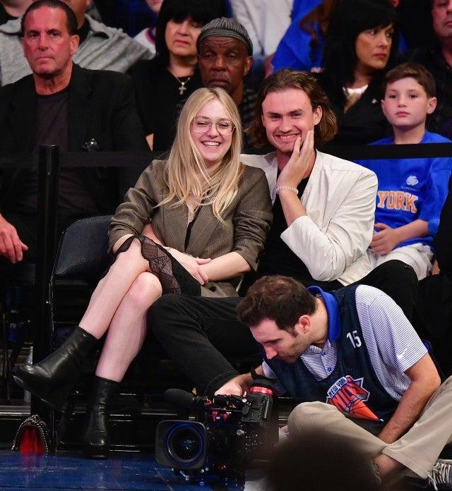 Dakota Fanning and boyfriend at Knicks game