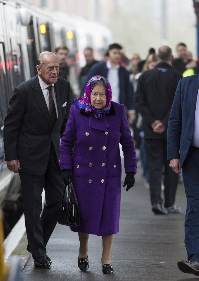 Queen Elizabeth II and Prince Philip travel for the holidays