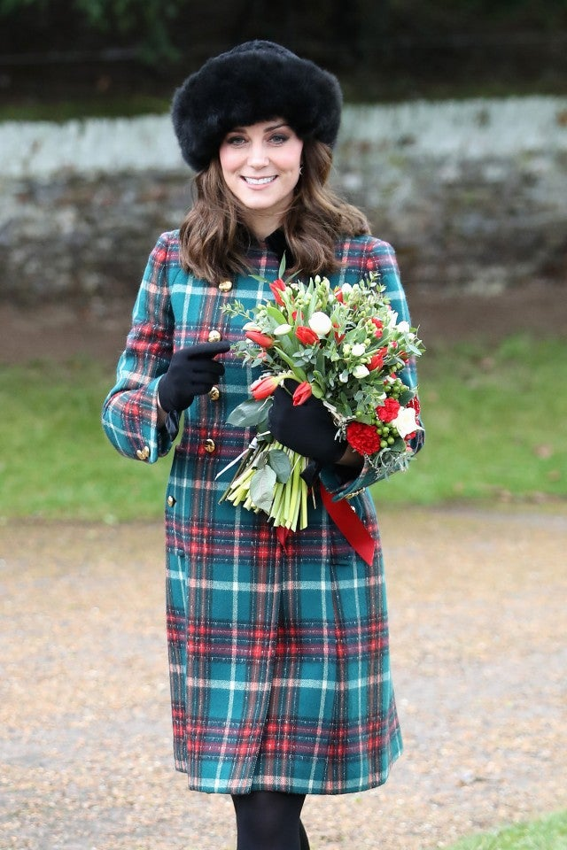 Kate Middleton holding flowers on Christmas