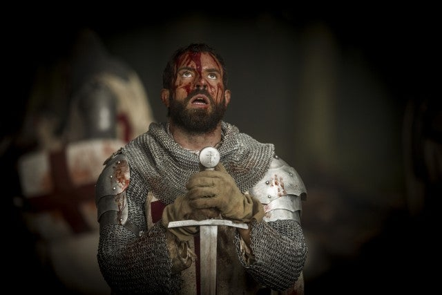 tom_cullen_as_landry_bowed_before_his_sword_in_historys_new_drama_series_knightfall_r_gold_1