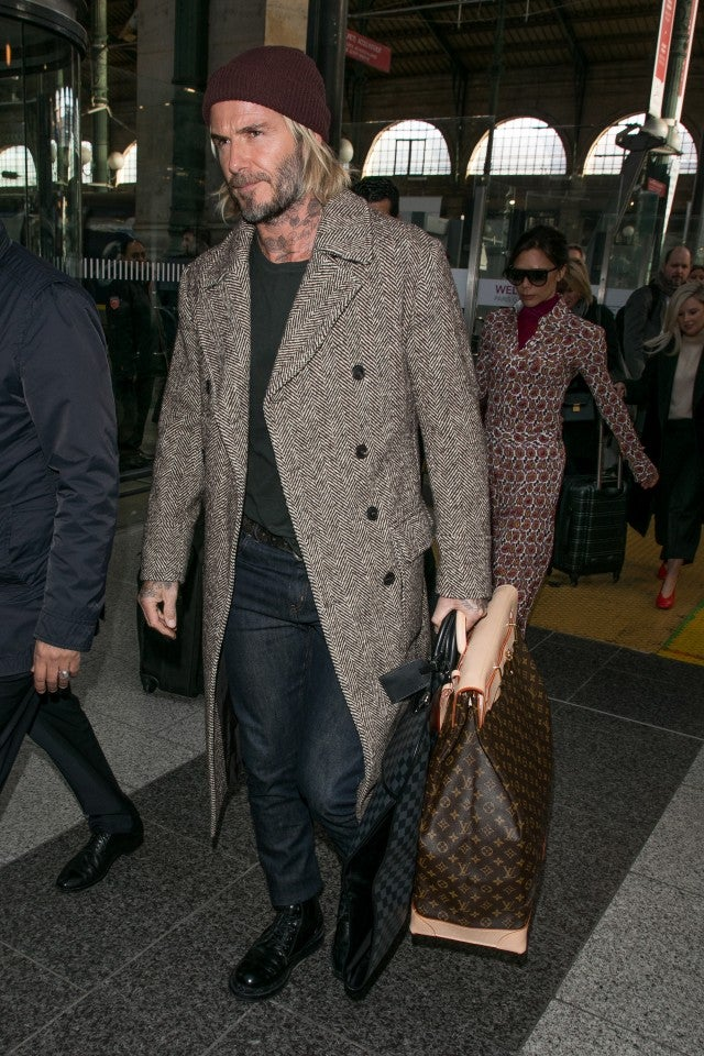 David And Victoria Beckham Stylishly Arrive In Paris