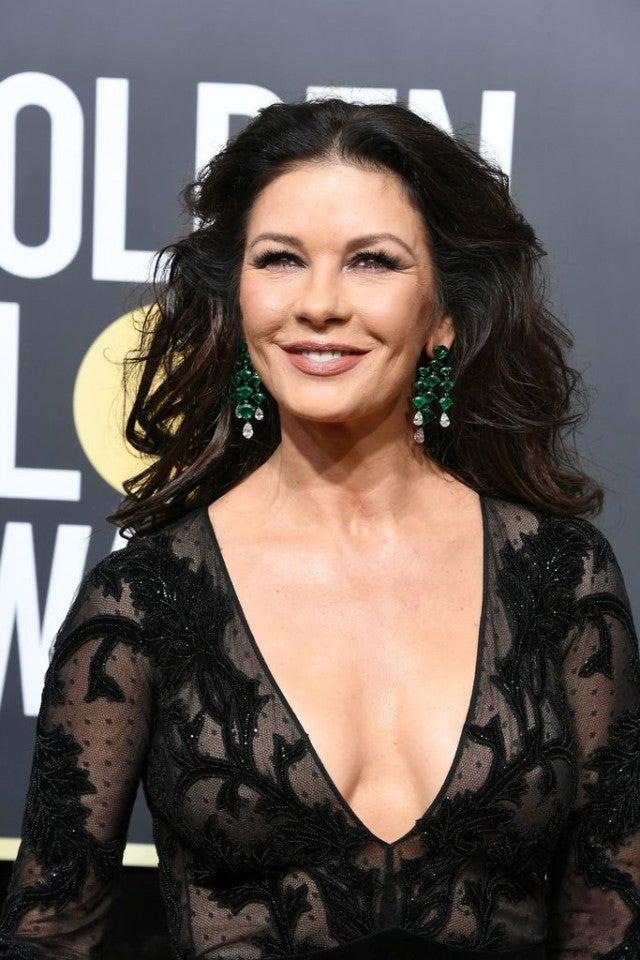 Catherine Zeta Jones Stuns In Sheer Black Gown At Golden