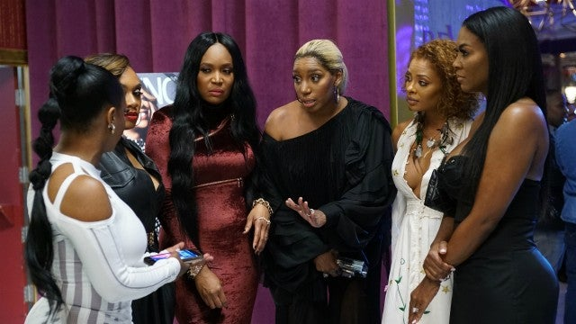 Eva Marcille talks with her 'Real Housewives of Atlanta' co-stars at Kandi Burruss' 'Essence Magazine cover party.