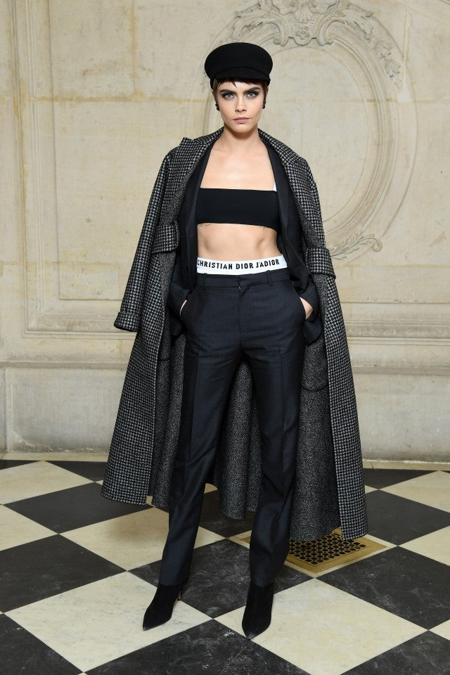 Cara Delevingne Leads The Pack Of Stylish Celebs Sitting