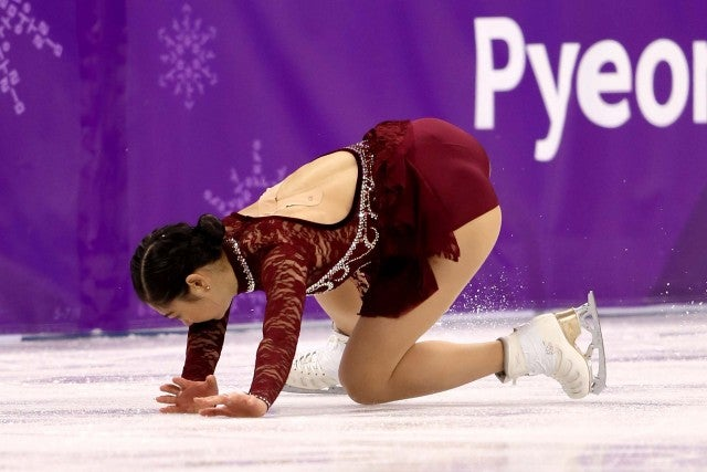 U.S. figure skater Mirai Nagasu falls during the women's short program at the 2018 Winter Olympics