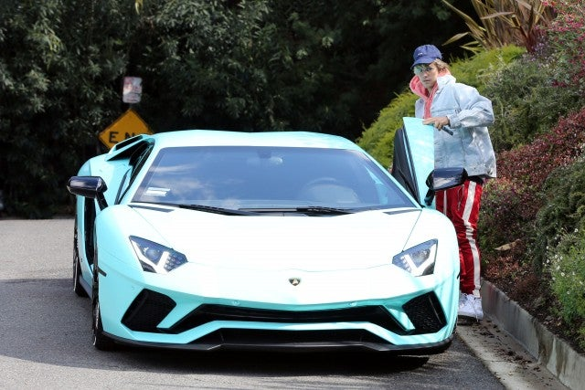 Justin Bieber drives a mint green Lamborghini on his 24th birthday.