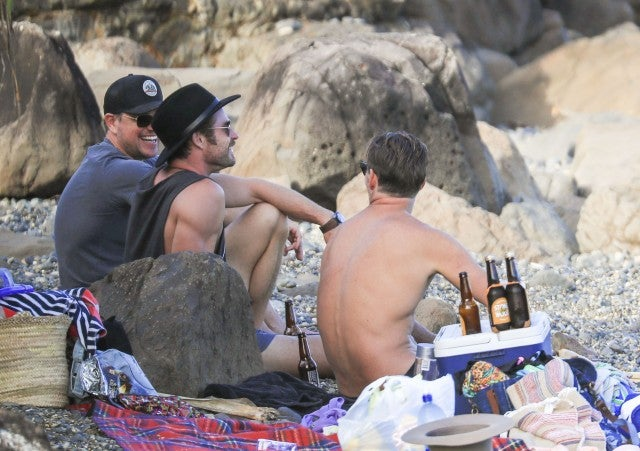Chris Hemsworth and Matt Damon on the beach in Australia.