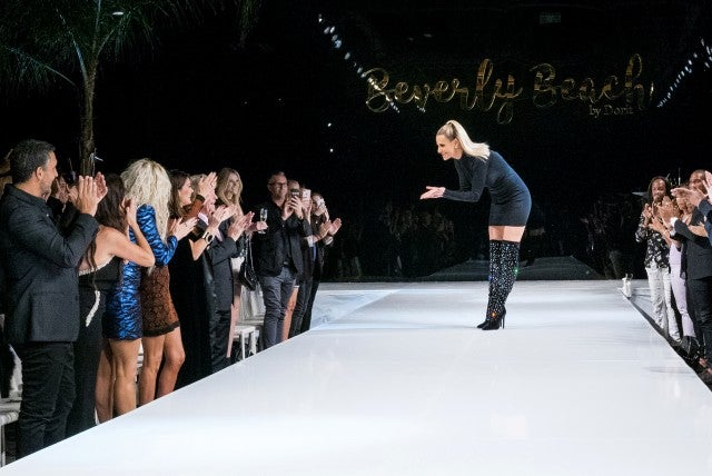 Dorit Kemsley thanks the crowd at her Beverly Beach by Dorit fashion show launch, as seen on 'The Real Housewives of Beverly Hills.'