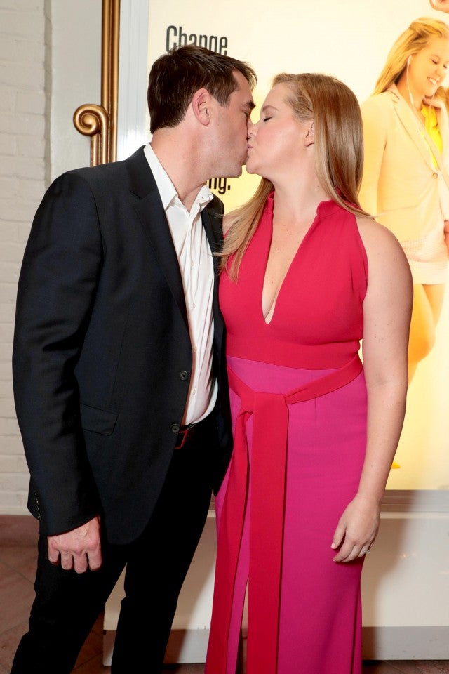 Amy Schumer and husband at I Feel PRetty premiere