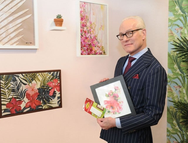 Tim Gunn hangs photos