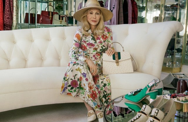 Faye Dunaway Gucci on couch