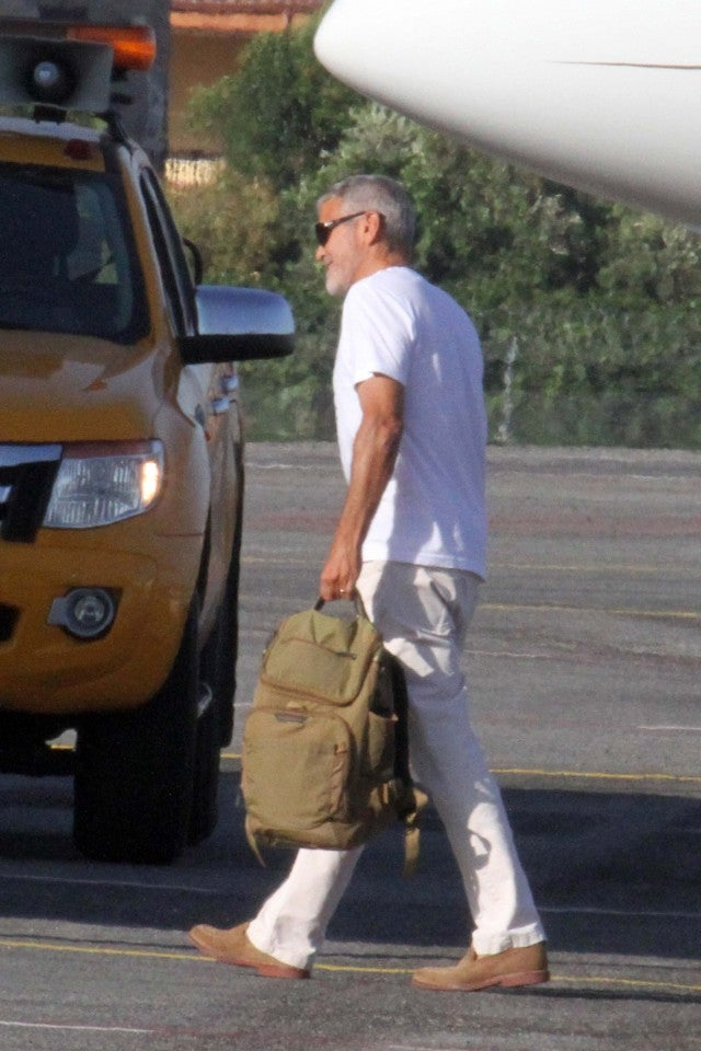 George Clooney walks unassisted at an airport in Rome 5 days after scooter accident